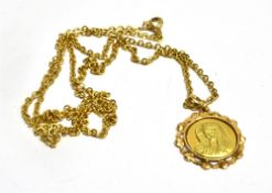 AN 18CT YELLOW MOTHER MARY ROUND PENDANT and 9ct gold chain, the pendant with decorated pierced