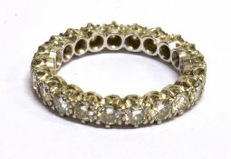 A DIAMOND AND PLATINUM FULL ETERNITY RING A total of twenty-one round brilliant cut diamonds, a