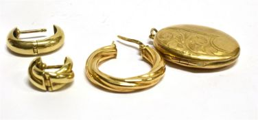 THREE ODD 9CT GOLD EARRINGS and a 9ct gold back and front locket, the earrings weighing a total of
