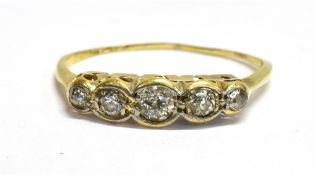 A DIAMOND FIVE STONE 18CT YELLOW GOLD RING The five round old cut diamonds weighing a total of