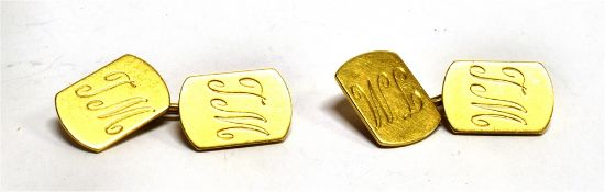 A PAIR OF 18CT GOLD CHAIN LINKED CUFFLINKS script initial T.M., of rounded rectangular shape,