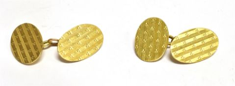 A PAIR OF 18CT GOLD OVAL CHAIN LINKED CUFFLINKS with engine turned pattern, hallmarks for 1919,