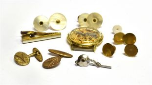 A SET OF FOUR 9CT GOLD GENT'S DRESS STUDS each stamped 9c, weighing a total of approx. 4.9 grams,