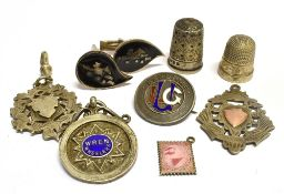 EIGHT SMALL SILVER ITEMS comprising three shield fobs, an enamelled badge, a pair of cufflinks,