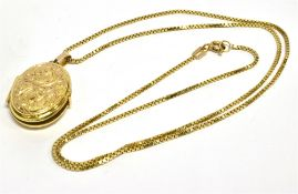 A 9CT GOLD LOCKET AND CHAIN the oval scroll pattern locket 22mm x 18mm, on a 9ct gold box link chain