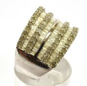 A DIAMOND SET EIGHT ROW SILVER RING the front section comprising alternating rows of small round
