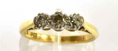 A DIAMOND THREE STONE RING the round brilliants approx. 0.60cts, claw set in white, on a yellow '