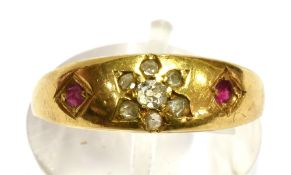 A c1900 DIAMOND AND RUBY SET 18CT GOLD BAND RING the front inset with a small diamond flower head
