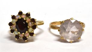 TWO 9CT GOLD DRESS RINGS comprising a garnet and opal three tier cluster, ring size L, and a white