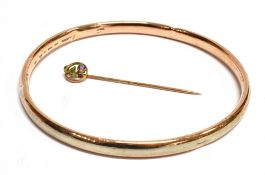 A 9 CARAT GOLD STICK PIN the head set with a small amethyst and two seed pearls, stamped 9C to