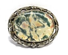 A MOSS AGATE AND SILVER OVAL BROOCH the polished oval piece of moss agate 35mm x 27mm, the silver
