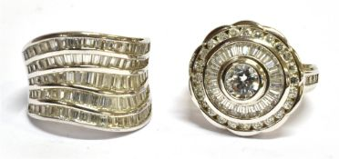 TWO WHITE CUBIC ZIRCONIA SET SILVER DRESS RINGS comprising a target style round cluster ring with CZ