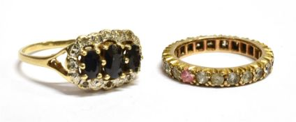 TWO 9CT GOLD STONE SET DRESS RINGS comprising a sapphire and small diamond oval cluster (note two