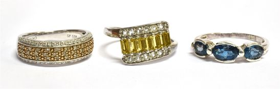 THREE SILVER DRESS RINGS one a diamond set half eternity band ring, comprising pave set small