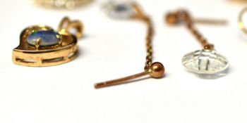 A QUANTITY OF FIVE 9 CARAT GOLD ASSORTED EARRINGS comprising studs and drops, together with a 9