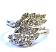 A DIAMOND FANCY CLUSTER 9CT WHITE GOLD RING The stylised diamond spray head to white gold, staggered
