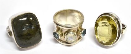 THREE LARGE STONE SET SILVER DRESS RINGS comprising a large oval cut citrine, approx. 22mm x 17mm,