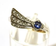 A BLUE AND WHITE STONE SET 9CT GOLD RING small blue stone assessed as synthetic sapphire, fan shaped