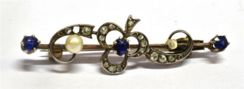 A VICTORIAN SAPPHIRE, DIAMOND AND SEED PEARL SET BAR BROOCH with clover and scroll design,
