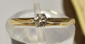 A 9 CARAT GOLD SINGLE STONE DIAMOND RING the brilliant cut of approximately 0.1 carat; with a pair