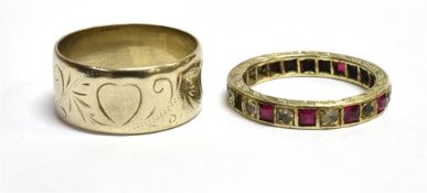 TWO 9CT WHITE GOLD RINGS comprising a patterned wedding band, heart and scroll decoration, 9mm wide,