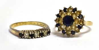 TWO 9CT GOLD SAPPHIRE AND WHITE STONE SET DRESS RINGS comprising a three tier cluster and a seven