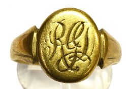 A GENTS 9CT GOLD SIGNET RING the oval head with monogrammed initials, ring size S, weighing