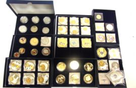 ASSORTED COLLECTOR'S COINS in nine storage boxes, (total 45 coins).