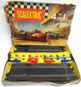 A SCALEXTRIC SET 80 comprising a C72, B.R.M., British Racing Green with a white nose, racing