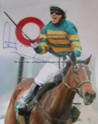 Signed photographic print of the jockey A.P. McCoy, signed in blue marker pen, McCoy depicted at the