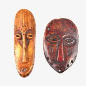 Tribal Art: Two miniature African carved bone and ivory face masks, Lega tribe, Kongo.