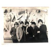 The Rolling Stones: A large photograph signed by five members of the band, circa 1963.