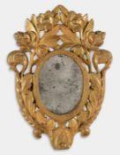 Specchierina ovale in legno intagliato e dorato, seconda metà del XIX sec.