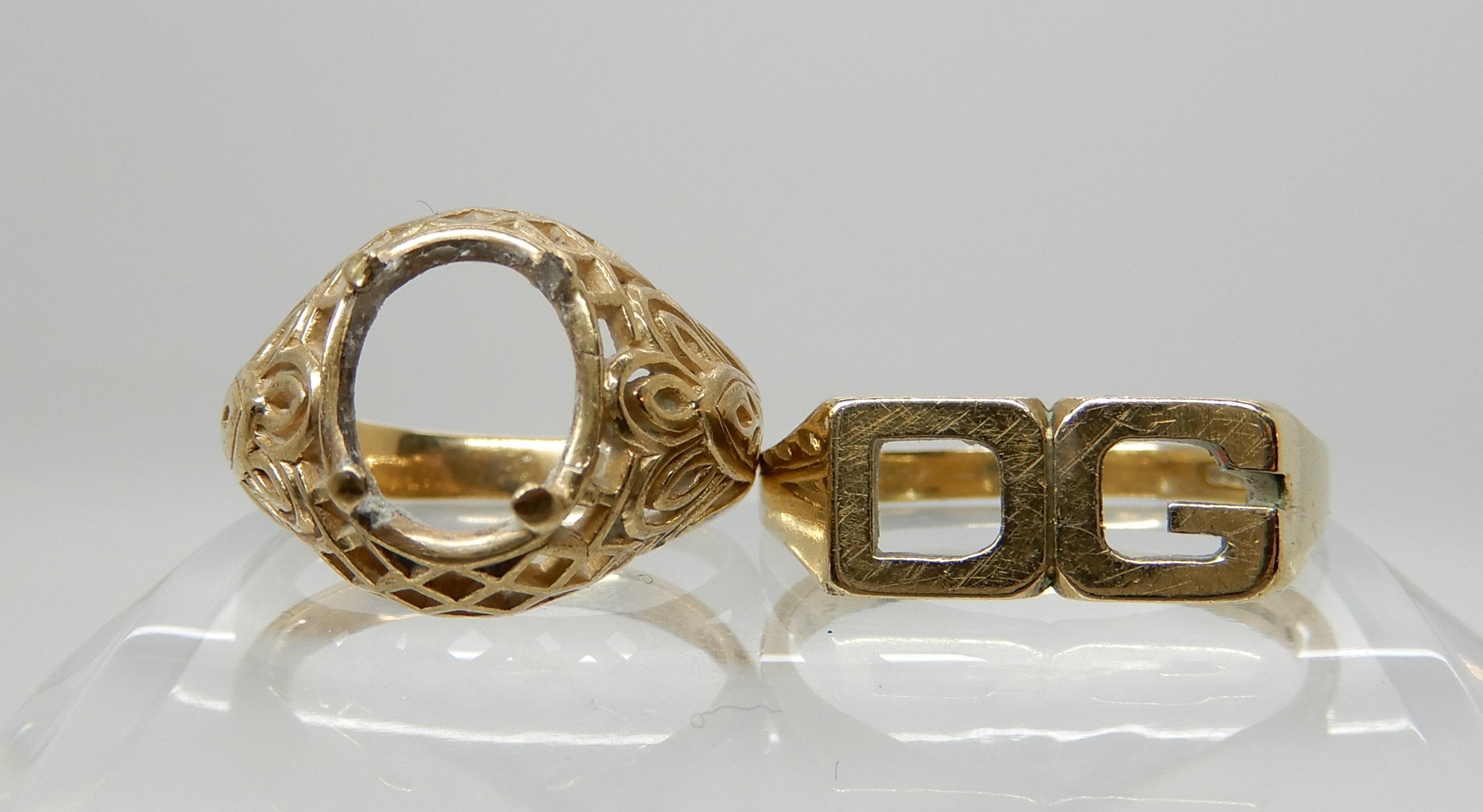 Lot 18 - A 9ct initial ring 'DG' size Q1/2 and a decorative yellow metal ring shank without stone size K1/