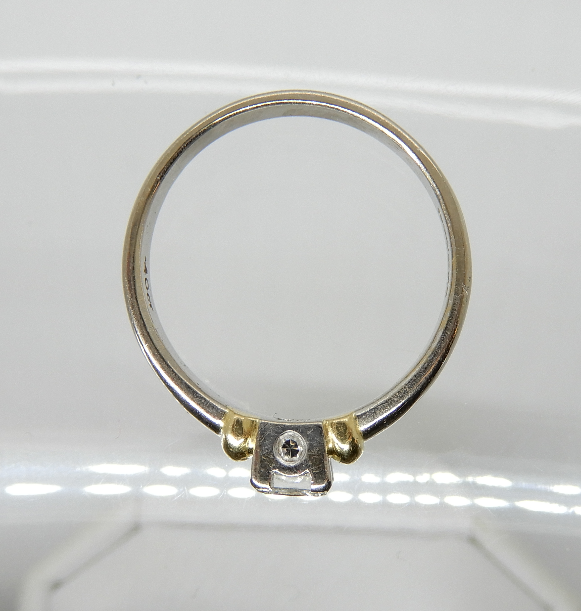 Lot 16 - An 18ct white and yellow gold princess cut diamond ring set with estimated approx 0.40cts, with