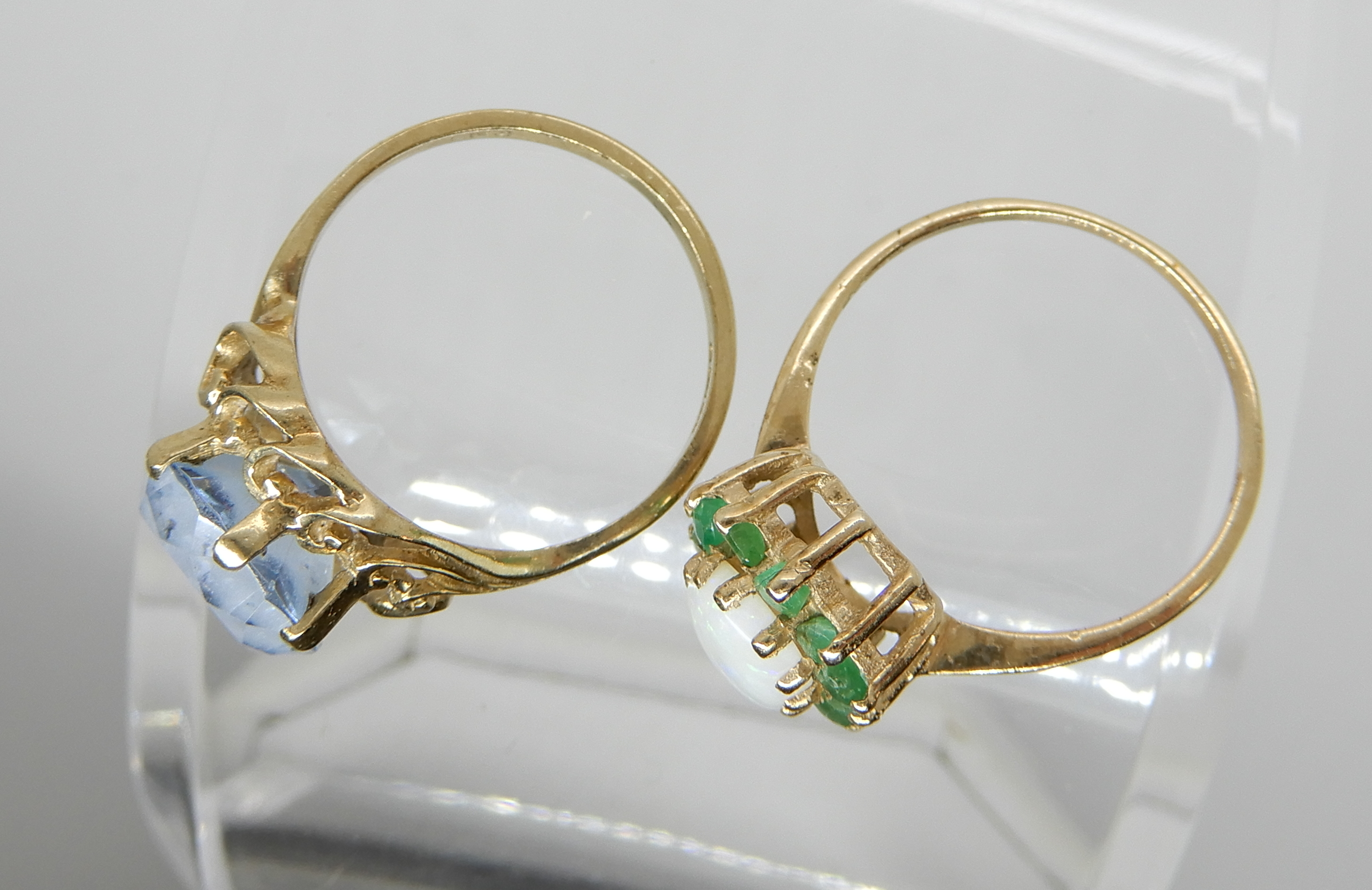 Lot 12 - A 9ct gold opal and emerald cluster ring size N/12 and a 9ct blue gem set ring with scroll setting