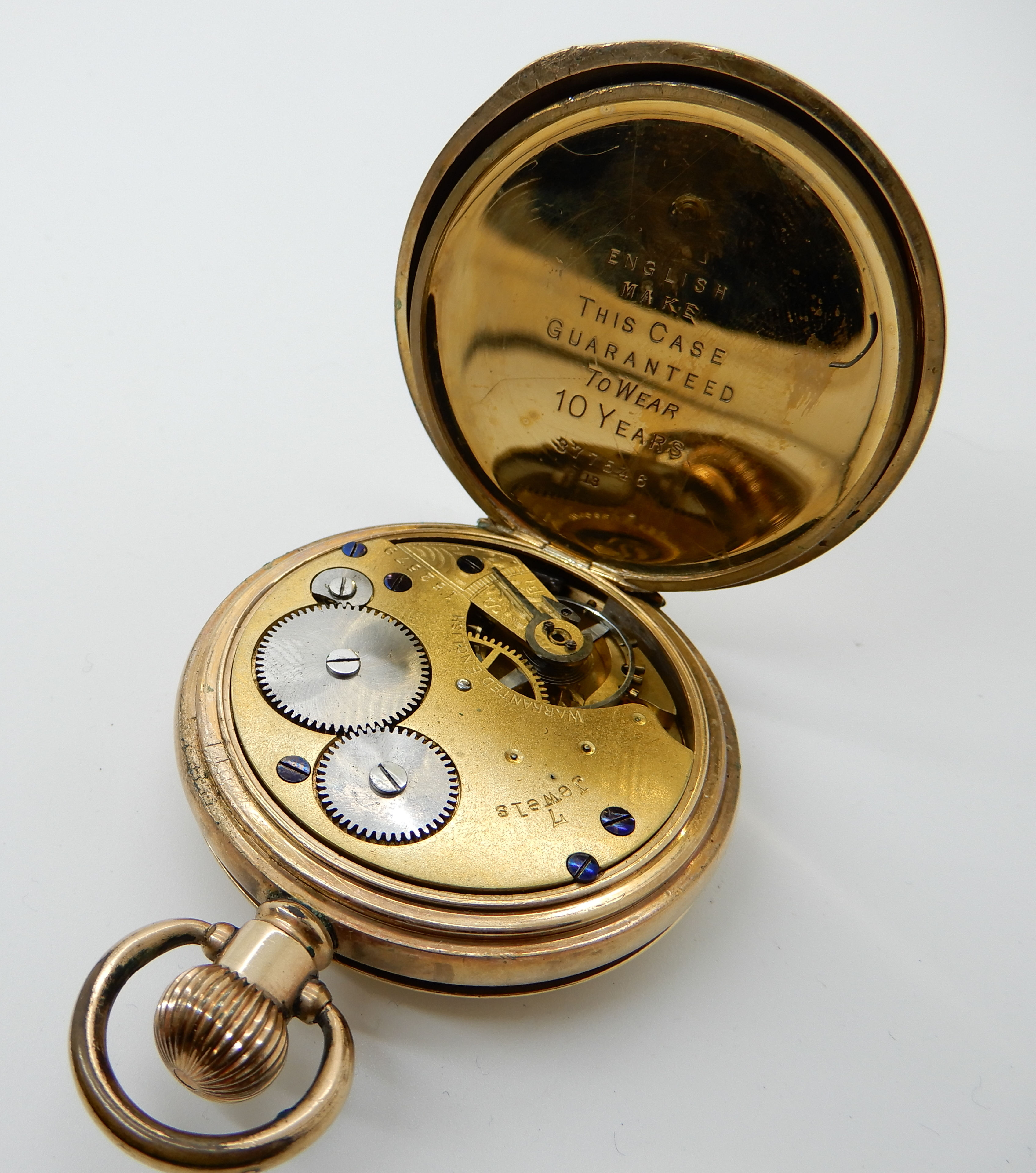 Lot 22 - A gold plated half hunter pocket watch with enamelled chapter ring, retailed by Street & Co