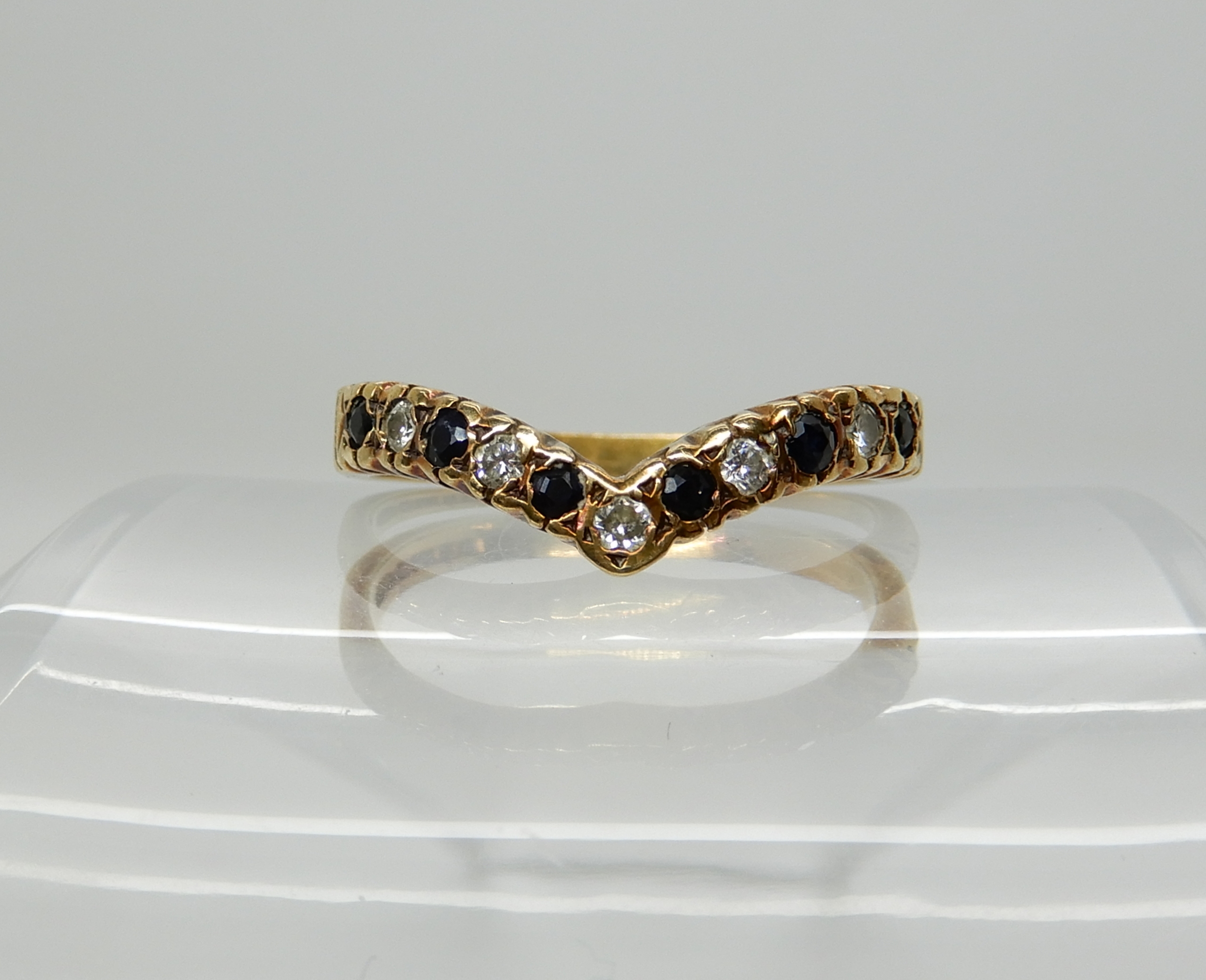 Lot 9 - A 9ct herringbone shaped ring set with sapphires and diamonds, size U1/2, weight 3gms Condition