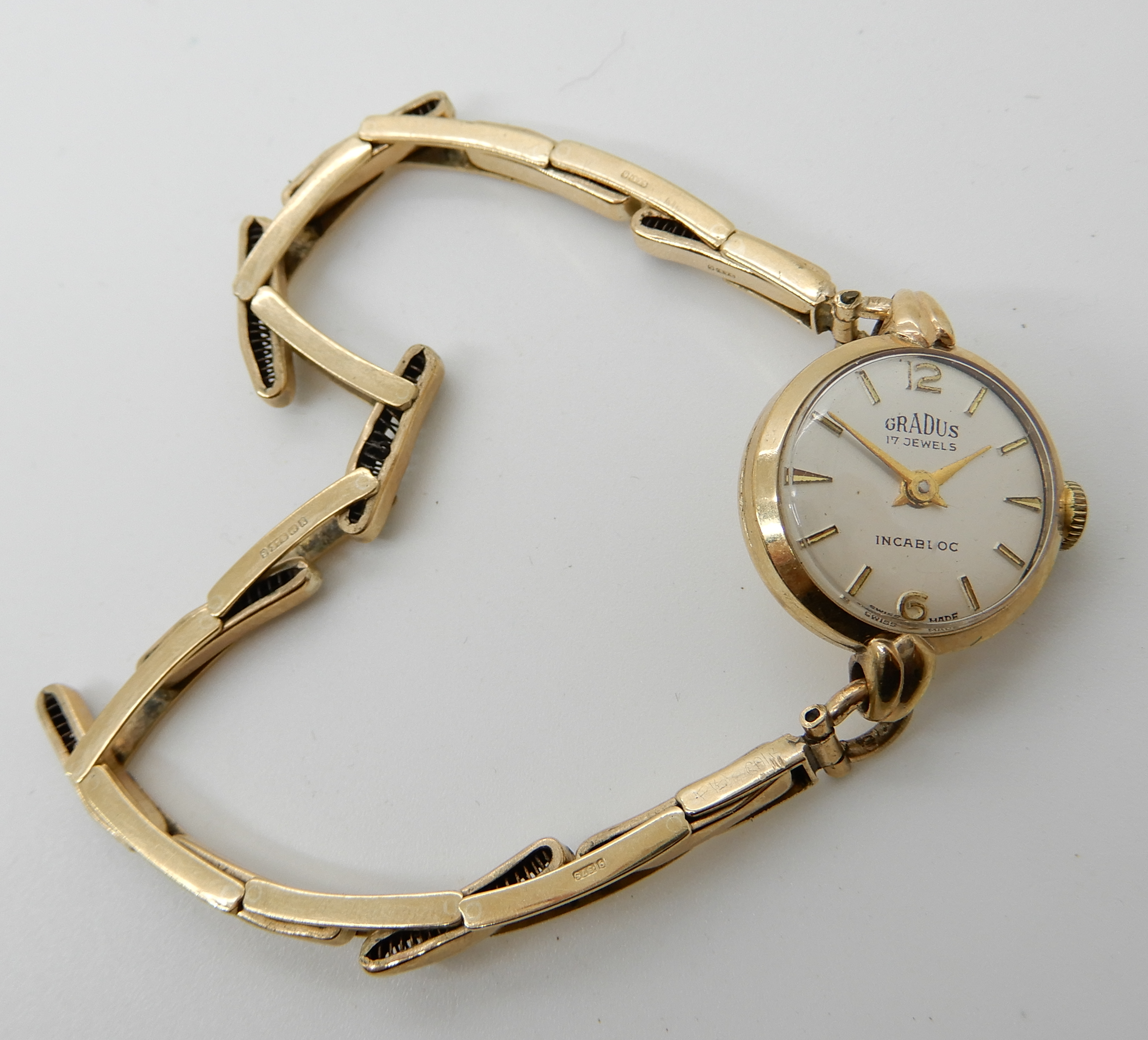 Lot 28 - A 9ct Gradus ladies vintage watch and expanding strap, weight including mechanism 11.5gms
