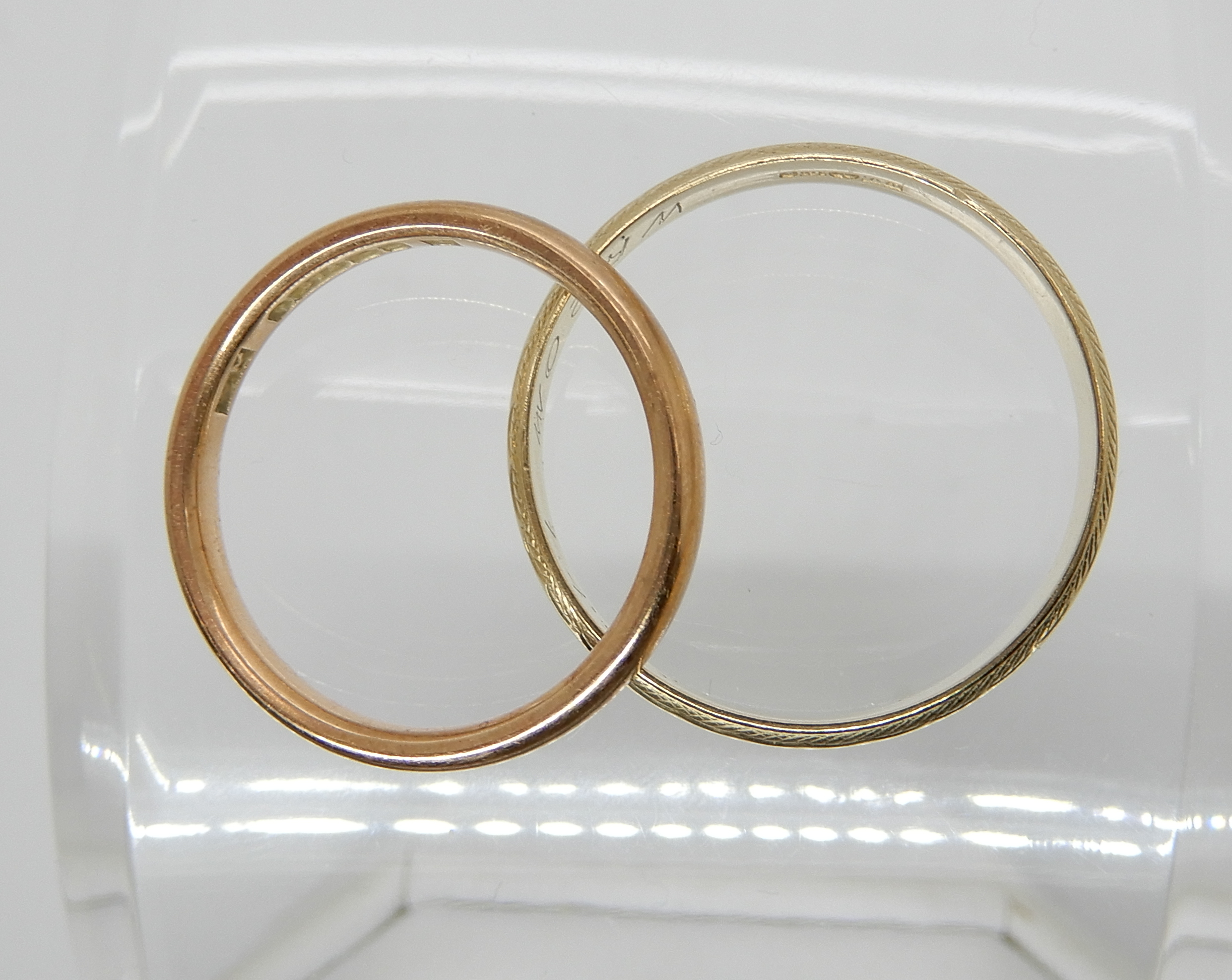Lot 4 - A 9ct rose gold wedding ring size O and a 9ct yellow gold example size V1/2, combined weight 5gms