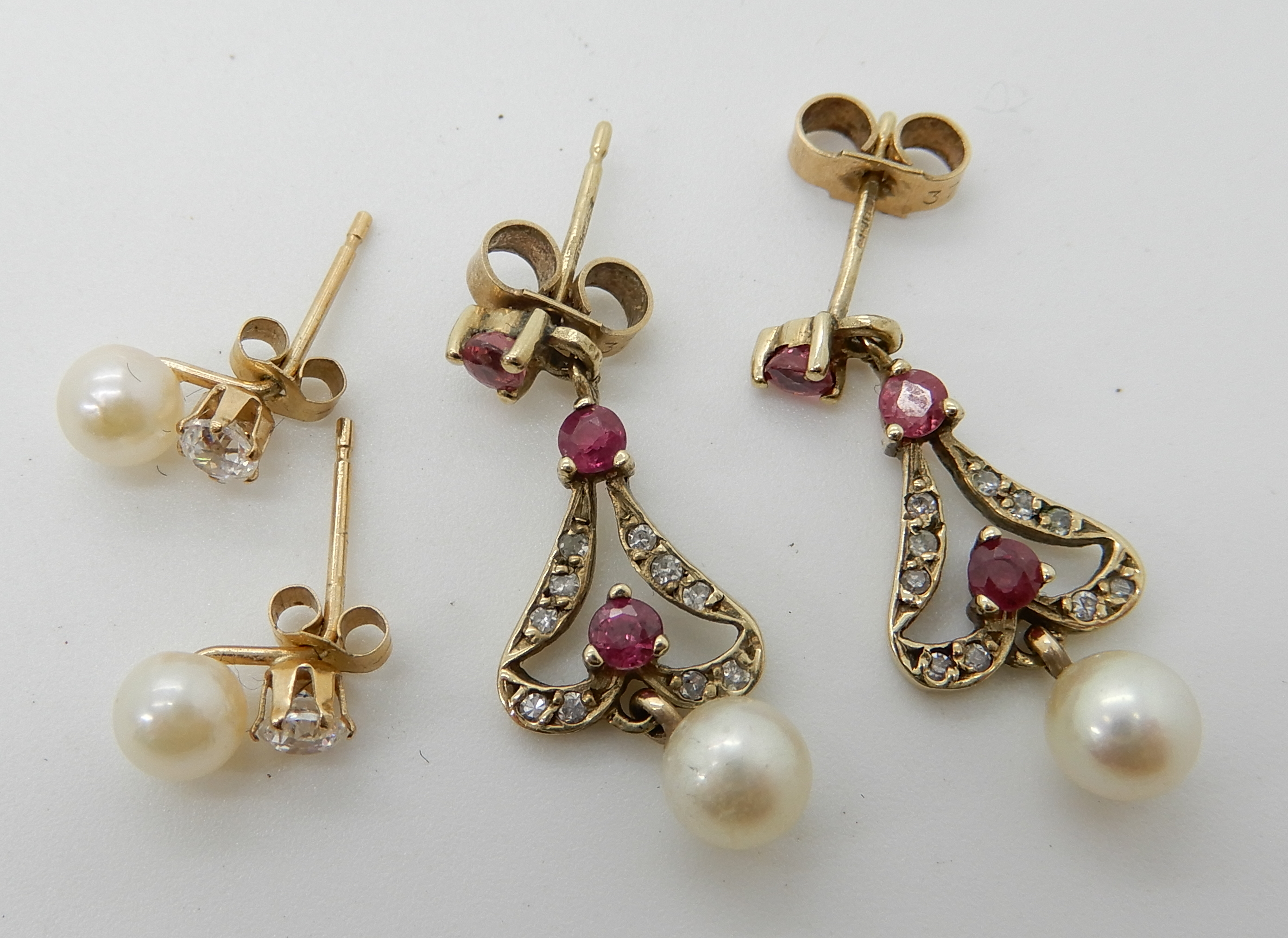 Lot 56 - A pair of 9ct diamond, ruby and pearl earrings, together with a further pair of pearl and cz