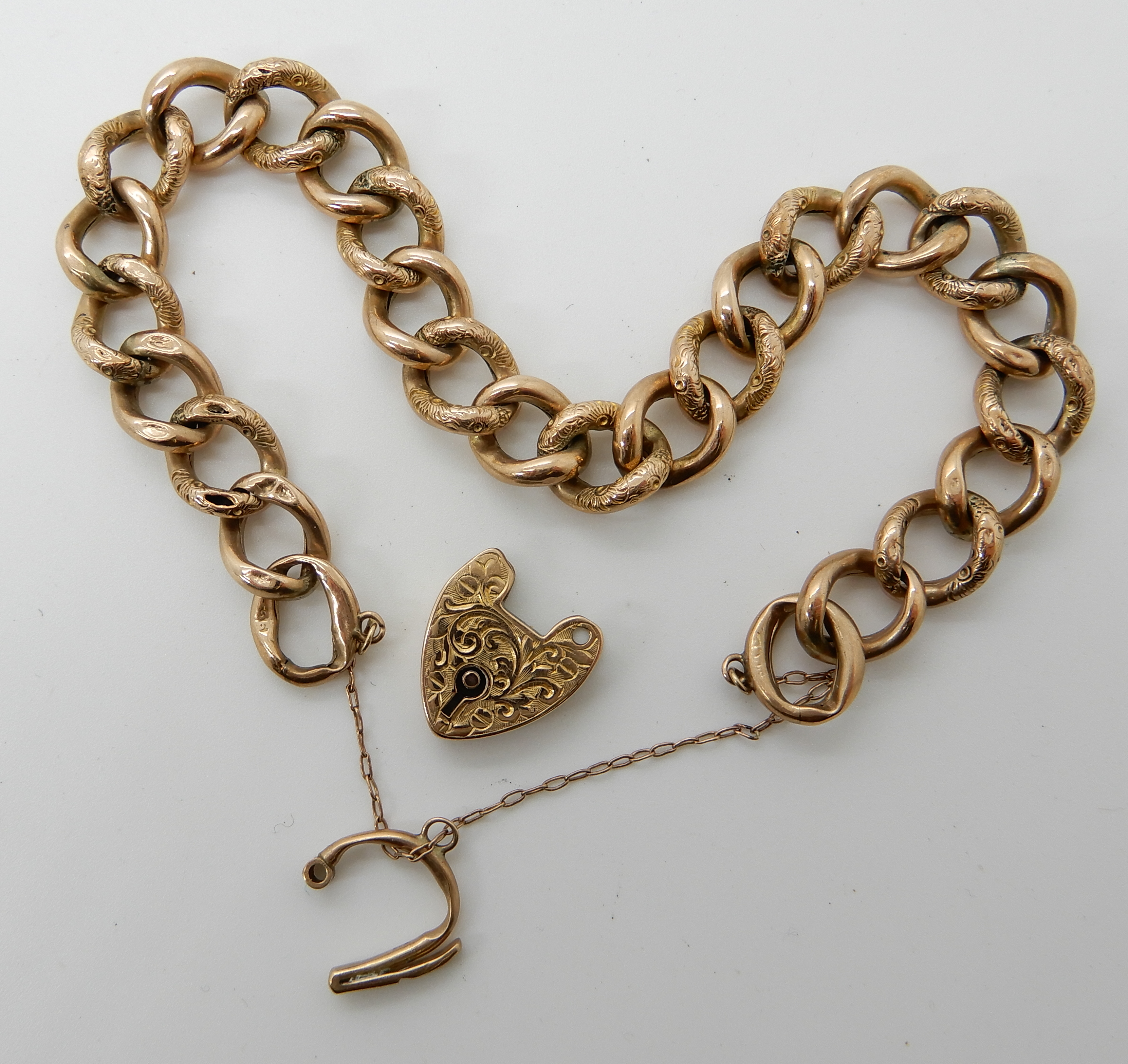 Lot 48 - A 9ct gold hollow construction curb link bracelet with heart shaped clasp (af) Condition Report: