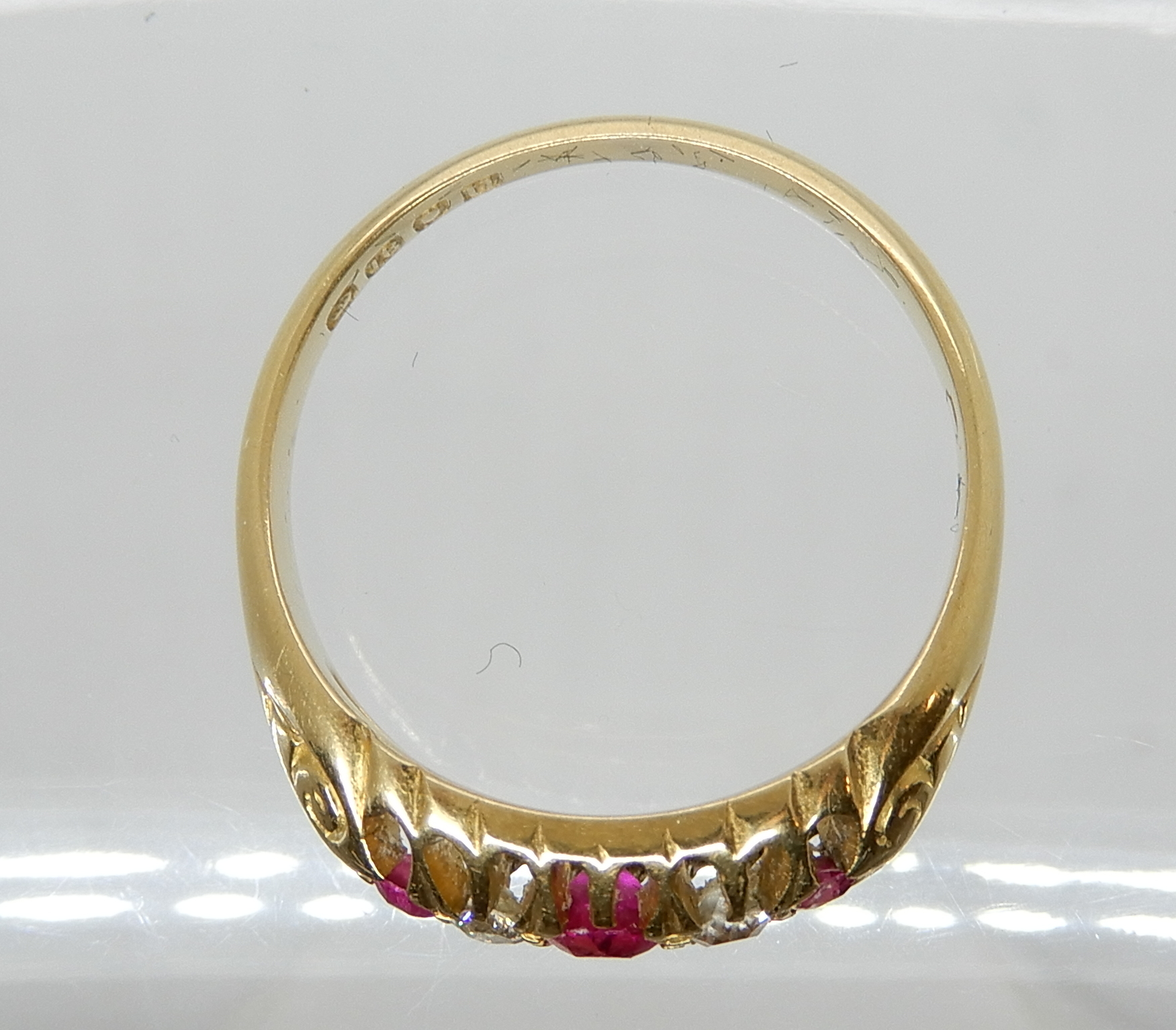 Lot 40 - An 18ct gold diamond and red gem ring, size O, weight 3.7gms Condition Report: Available upon