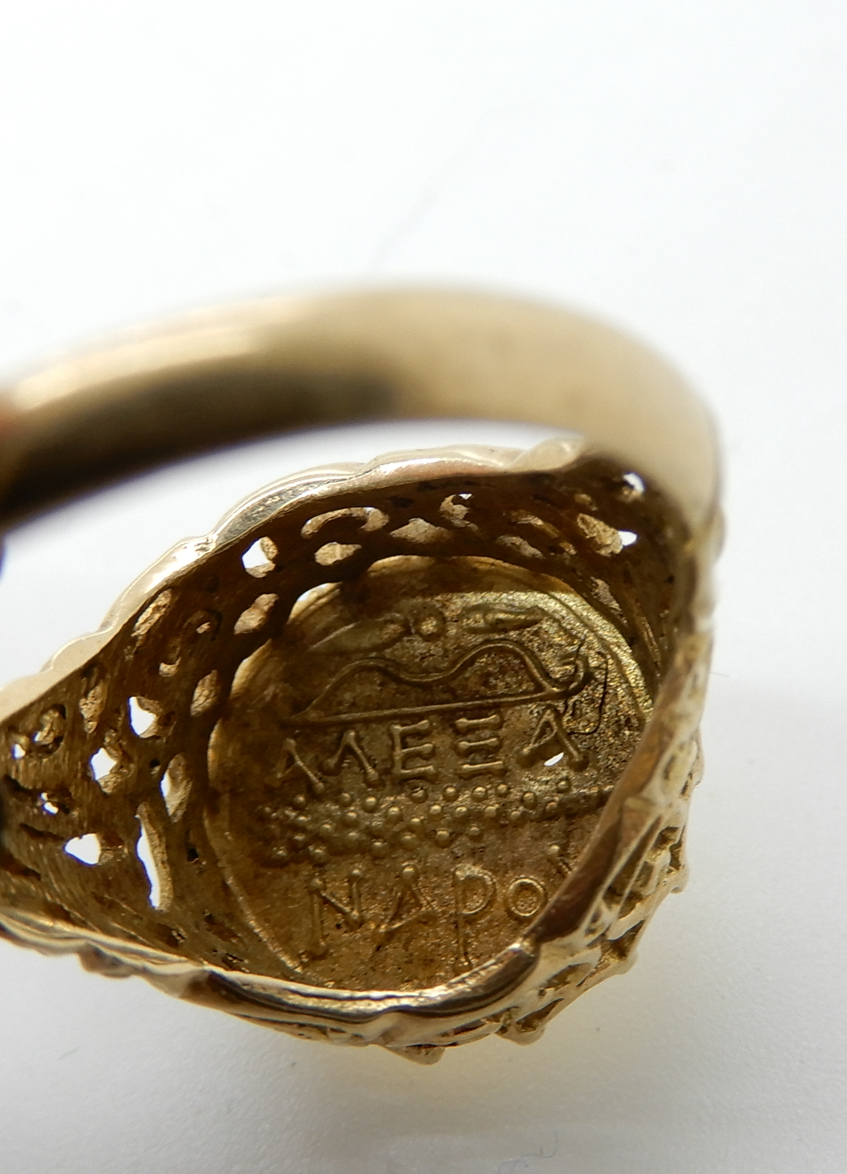 Lot 17 - A 14k ring stamped 585, set with a Greek style coin, size P, weight 4.4gms Condition Report: