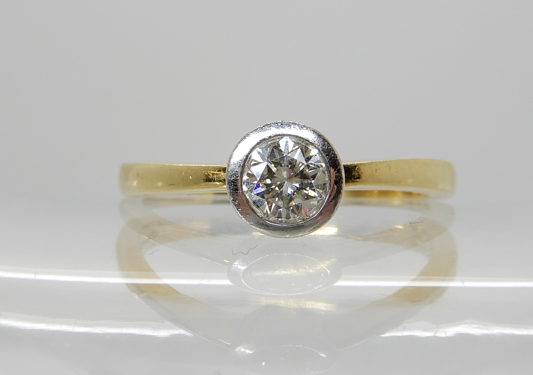 Lot 42 - An 18ct yellow gold diamond solitaire ring with an estimated approx 0.40ct diamond in a white gold