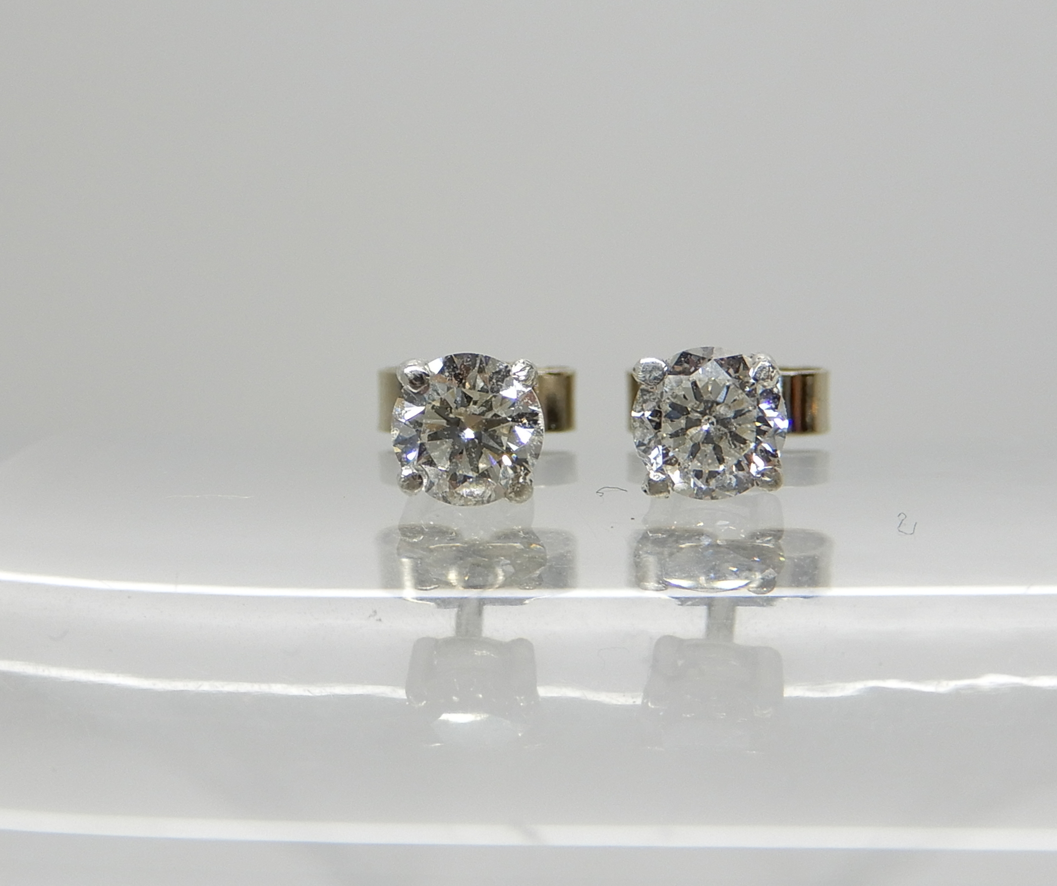 Lot 41 - A pair of white metal (butterflies stamped 750) diamond stud earrings of estimated approx 0.50cts