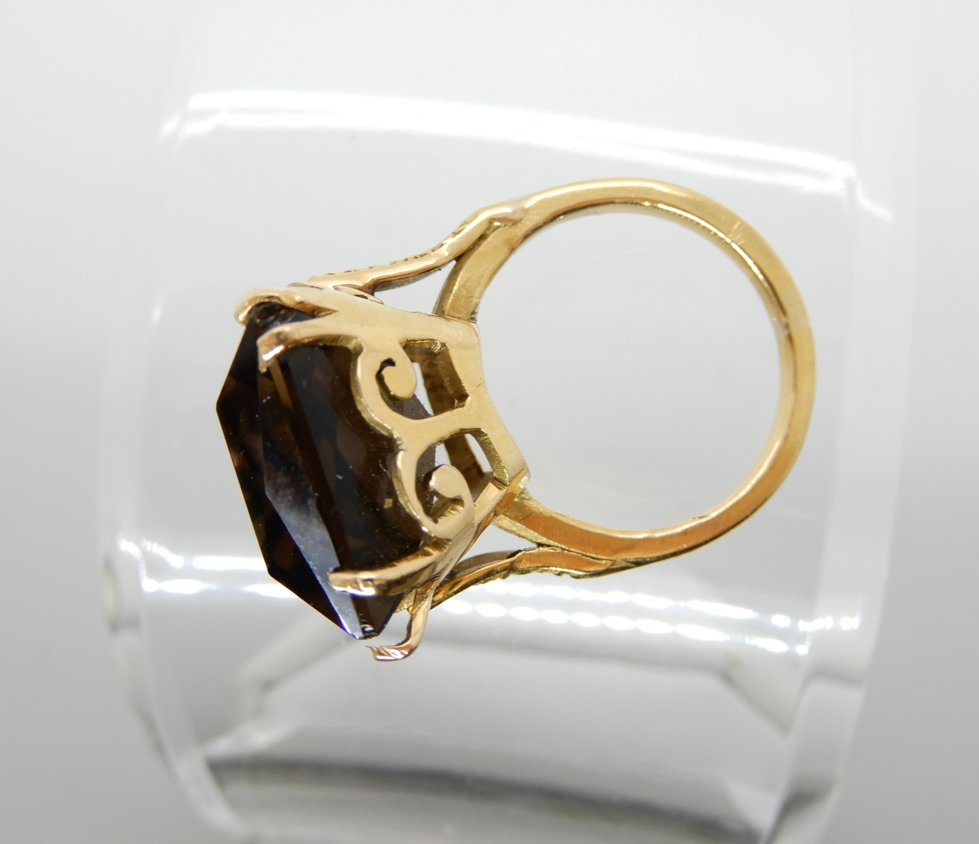 Lot 2 - A yellow metal mounted large smoky quartz set ring size O1/2, weight 11.8gms Condition Report: