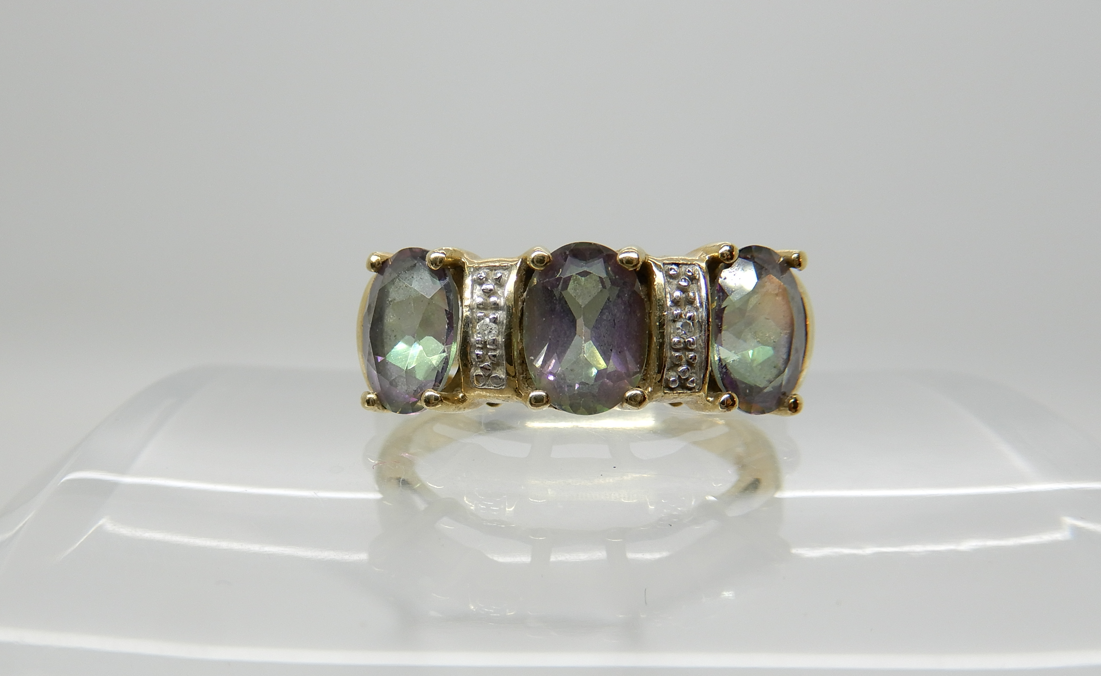 Lot 20 - A 9ct gold mystic topaz and diamond accent ring, size N1/2, weight 4.1gms Condition Report: