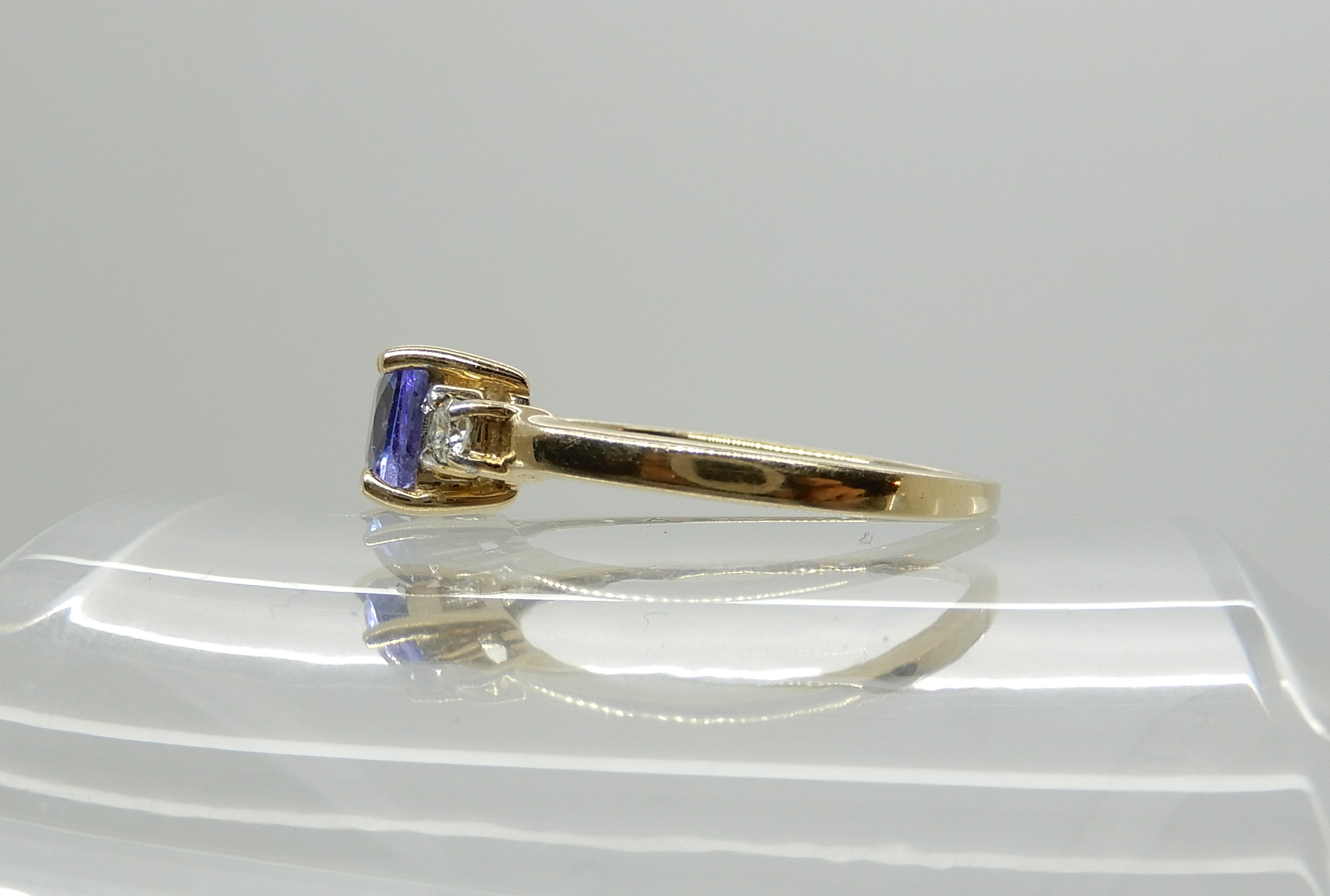 Lot 43 - A 9ct gold tanzanite and diamond ring, size Q, weight 2.3gms Condition Report: Available upon