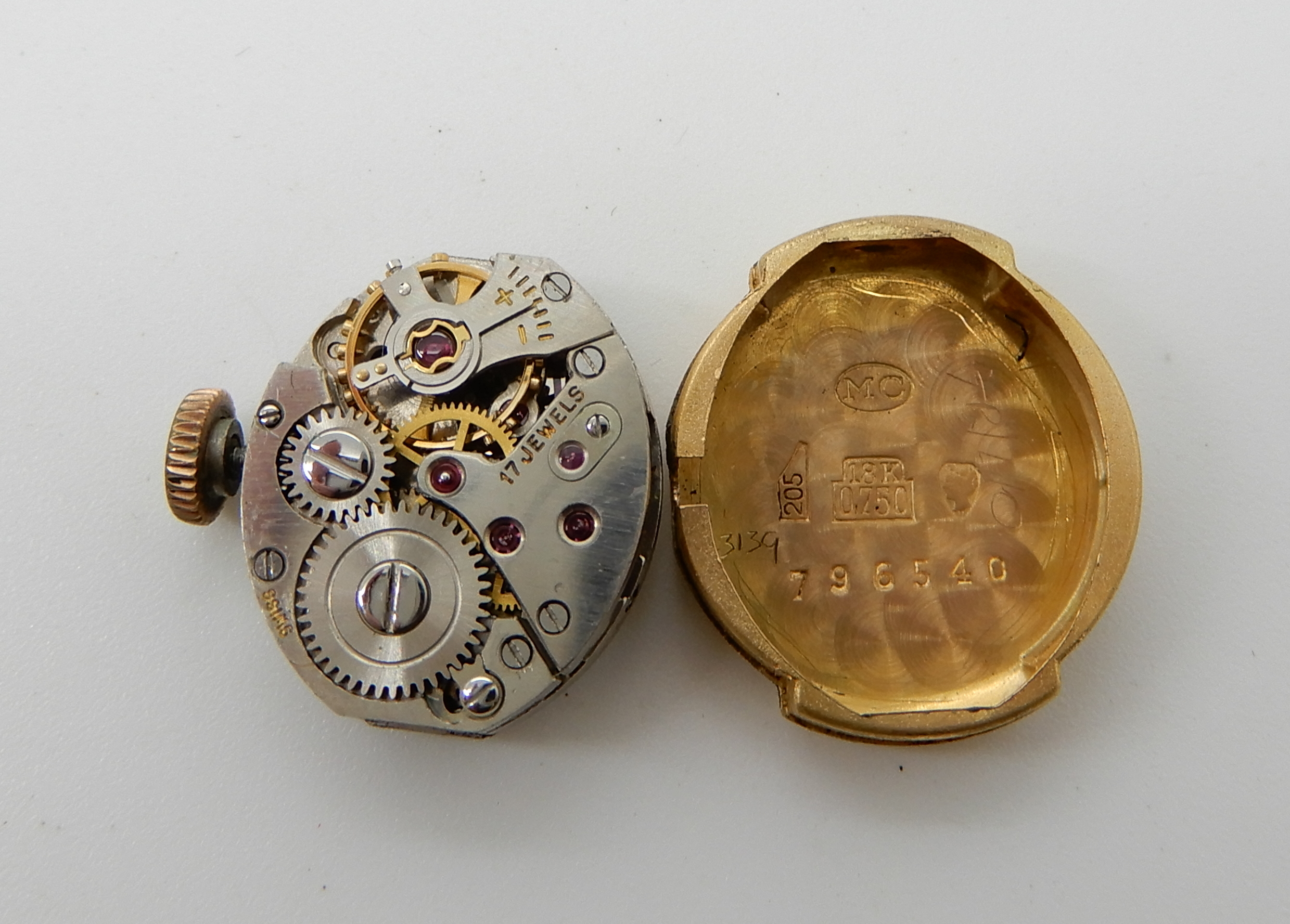 Lot 34 - An 18ct gold ladies Baume watch head, weight including mechanism 6.2gms Condition Report: